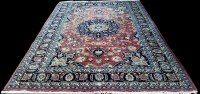 Lot 1093 - A Mashad carpet, the central rosette...