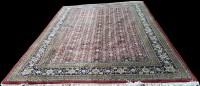 Lot 1095 - A Tabriz carpet, with flowerhead decoration on...