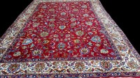 Lot 1096 - A Tabriz carpet, with full floral scrolls on a...