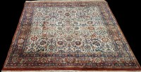 Lot 1097 - A Kashan rug, with floral scrolls on an ivory...