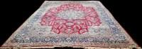 Lot 1099 - A Kirman carpet, the central rosette medallion...