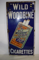 Lot 32-'Wild Woodbine Cigarettes' enamel advertising...