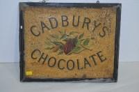 Lot 43 - A Cadburys chocolate tin advertising sign, by...