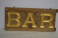 Lot 50 - A gold painted wooden ''Bar'' sign, 87 x 40cms.