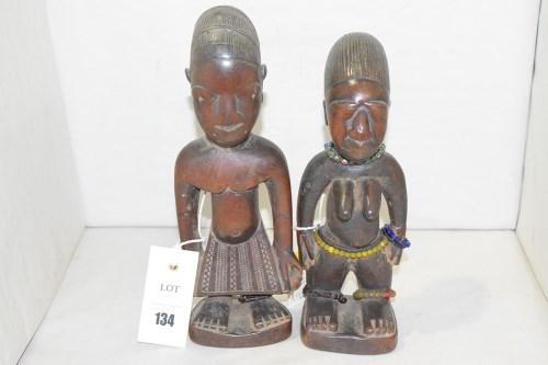 Lot 134-Yoruba Ibeji carved wooden male and female...