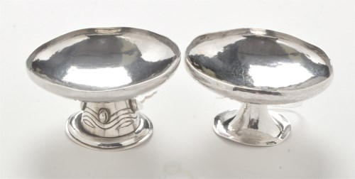 Lot 201-Two Edwardian silver Arts and Crafts table salts, ...