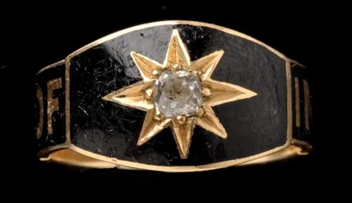 Lot 423-A Victorian black enamel, diamond and 18ct....