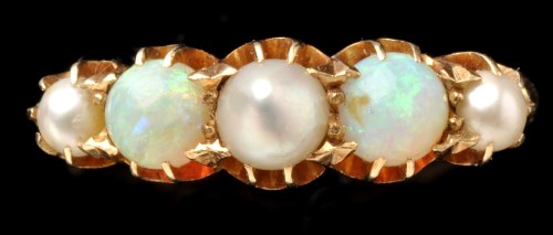 Lot 455-An opal and pearl ring, the two opal beads parted ...