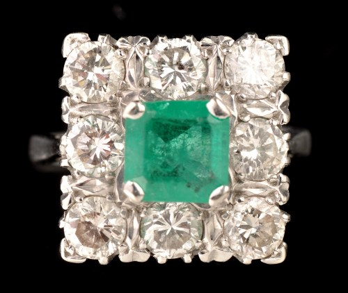 Lot 468-An emerald and diamond cluster ring, the central...