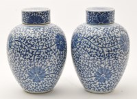 Lot 566 - Pair of Chinese blue and white jars and covers,...