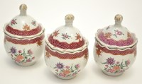 Lot 578 - Set of three Famille Rose jars with domed...