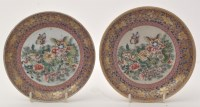 Lot 605 - Two Chinese famille rose saucer dishes, with...