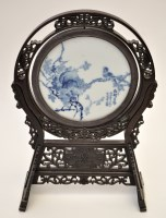 Lot 614 - Chinese blue and white circular panel, with...