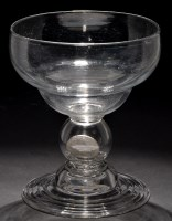 Lot 660 - Large coin goblet, ogee shaped bowl above...