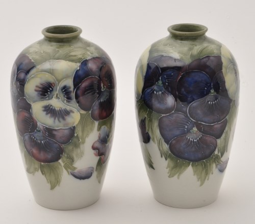 Lot 674-Pair of Moorcroft 'Pansy' vases, slender pear...