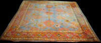 Lot 815-An antique Ushak carpet, decorated with bold...