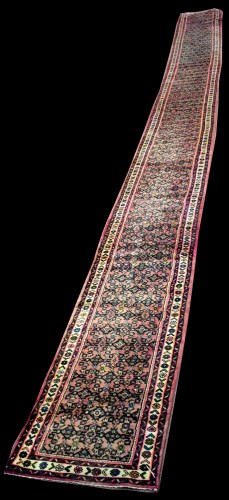 Lot 825-An extensive Sarough runner, with flowerhead...