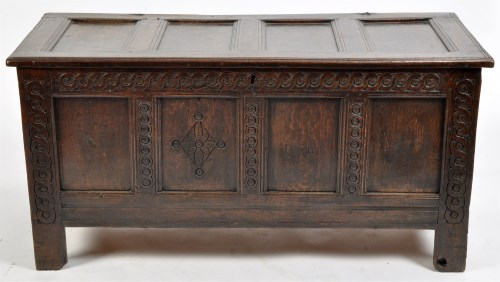 Lot 948-An oak coffer, the panel top opening to reveal a...