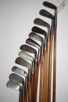 Lot 431-Twelve hickory shafted irons, to include:...