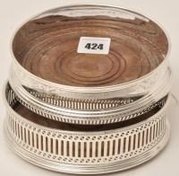Lot 424 - An Elizabeth II silver wine coaster, by A....