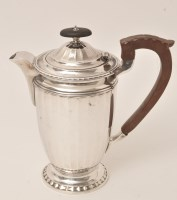 Lot 428 - A George V silver coffee pot, by Barker...