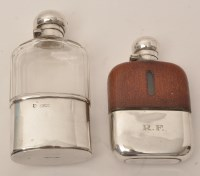 Lot 429 - A George V silver mounted glass hip flask, by...