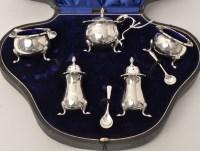 Lot 435 - A George V silver condiment set, by Fattorini...