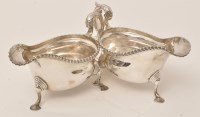 Lot 455 - A pair of George V silver sauce boats, by...