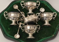 Lot 456 - A set of four George V silver table salts, by...