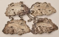 Lot 465 - Four mid 18th Century silver cast wine labels,...