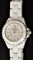 Lot 513 - Chanel: a white ceramic and diamond set quartz...