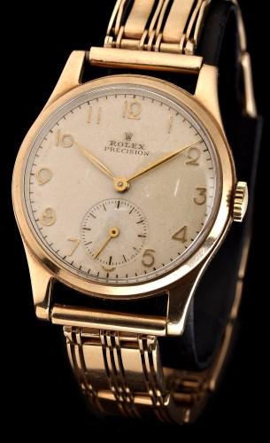 Lot 620-Rolex Precision: a gentleman's 9ct. gold cased...