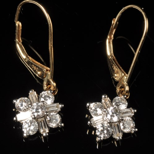 Lot 658-A pair of diamond drop earrings, each set with...