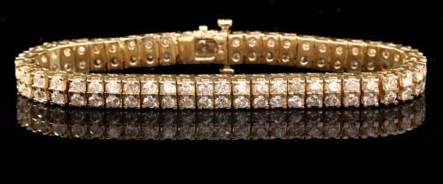 Lot 672-A diamond double row tennis bracelet, each link...