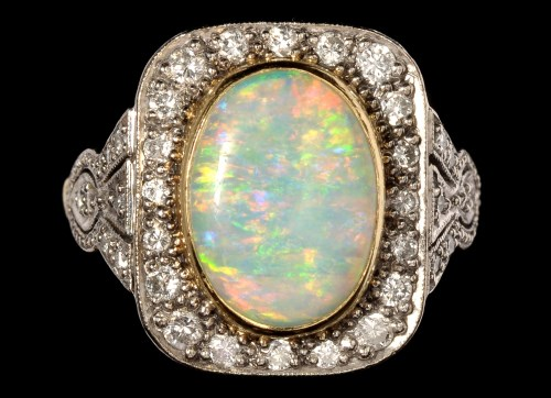 Lot 696-An opal and diamond dress ring, the oval opal...