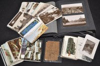 Lot 56A - An album of stocks and interest postcards and...