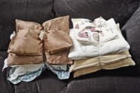 Lot 2 - Two bundles of miscellaneous modern cushions,...