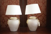 Lot 34 - A pair of ceramic table lamps in the form of...