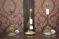 Lot 48 - Three early 20th Century brass table lamps,...