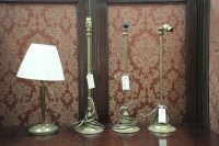 Lot 51 - Three matching brass table lamps (no shades);...