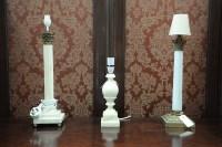 Lot 53 - Two corinthian column pattern table lamps, one...