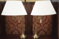 Lot 55 - A pair of modern lacquered brass adjustable...