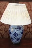 Lot 63 - A large ceramic table lamp in the form of a...