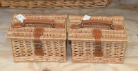 Lot 77 - Two small wicker lunch baskets, with leather...