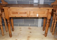 Lot 85 - A modern pine side table, fitted two frieze...
