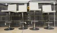 Lot 92 - A set of four modern bar stools, the seats and...