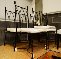Lot 94 - Fivemodern black painted wrought iron dining...