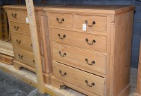 Lot 96 - A modern polished pine chest of drawers, the...