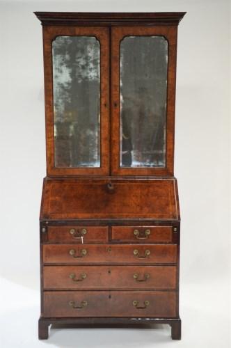 Lot 330-A George I walnut bureau cabinet, the top with...
