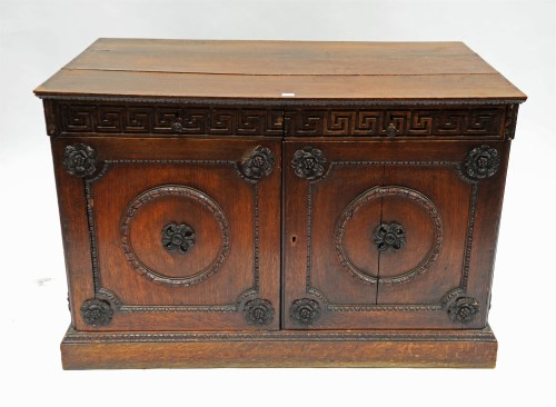 Lot 355-An early Georgian oak cabinet, possibly after a...